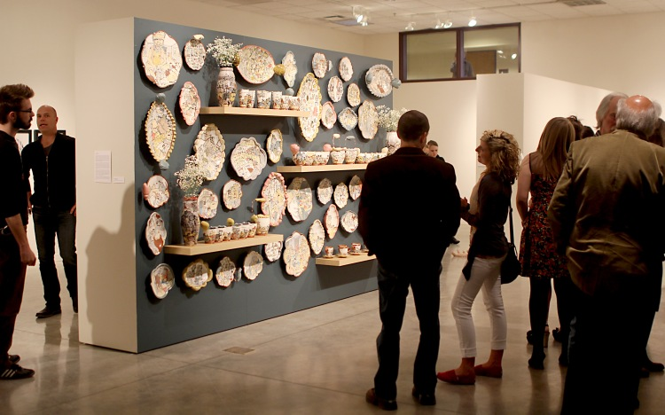 Many students, professors and community members attended the Bachlors of Fine Arts art and design exhibition where seniors showcased their thesis projects. Ceramics, drawings and print work were displayed, and several students had pieces for sale.