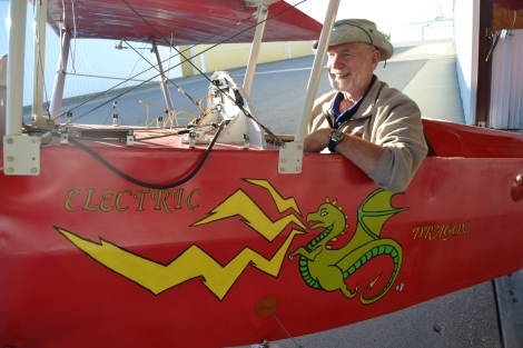 Physics professor Dennis Jacobs poses next to the Electric Dragon at the Detroit Lakes airport. His niece, a St. Paul artist, painted the dragon.