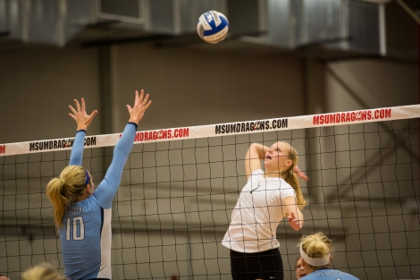 Abby Wolpren for MSUM goes for the kill in the match against Upper Iowa on Friday. Wolpren had 10 kills as the Dragons swept the Peacocks in three sets.
