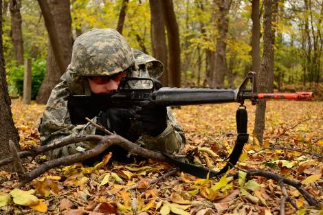 Brady Holte, an MSUM student and member of the Bison Battalion, provides security during tactical training at MB Johnson Park in north Moorhead.