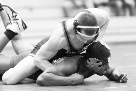 Junior Shawn Porter wrestles for the Dragons on Thursday. Porter picked up a pin in his match against Minot State. The Dragons won six of the matches, winning by pin in four of the matches. Photo by Ben Gumeringer